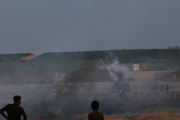 Palestinian protesters clashes with Israeli troops along the Gaza Strip border